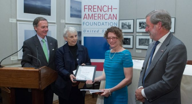 Alison Dundy is given her prize by Charles Kolb, Linda Asher, and Allan Chapin.